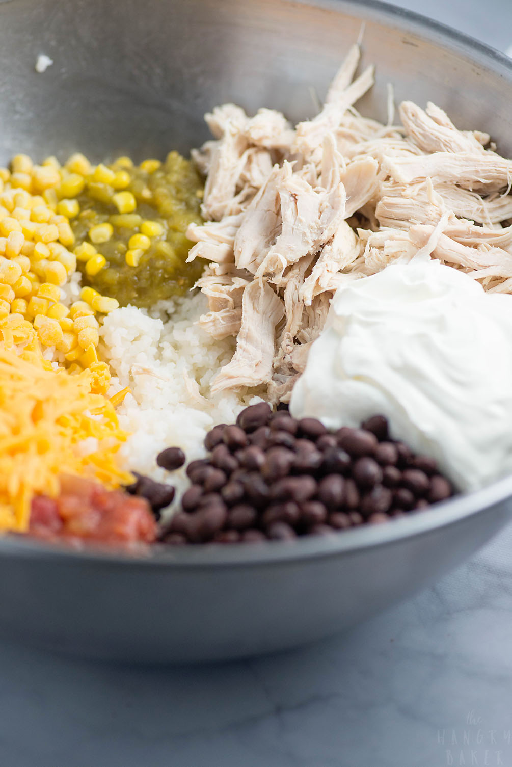 Cheesy Rice, Chicken and Bean Bake - An easy meal packed with flavors! Moist chicken, salsa, gooey cheese, beans and tender rice will please any family!