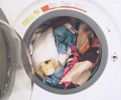 washing machine full of baby bedding