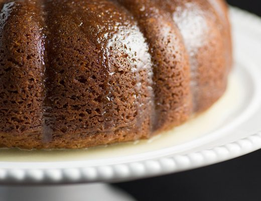 White Wine Cake - This super moist cake tastes exactly like a glazed donut! A warm buttery glaze tops this deliciously soft and addictive cake!