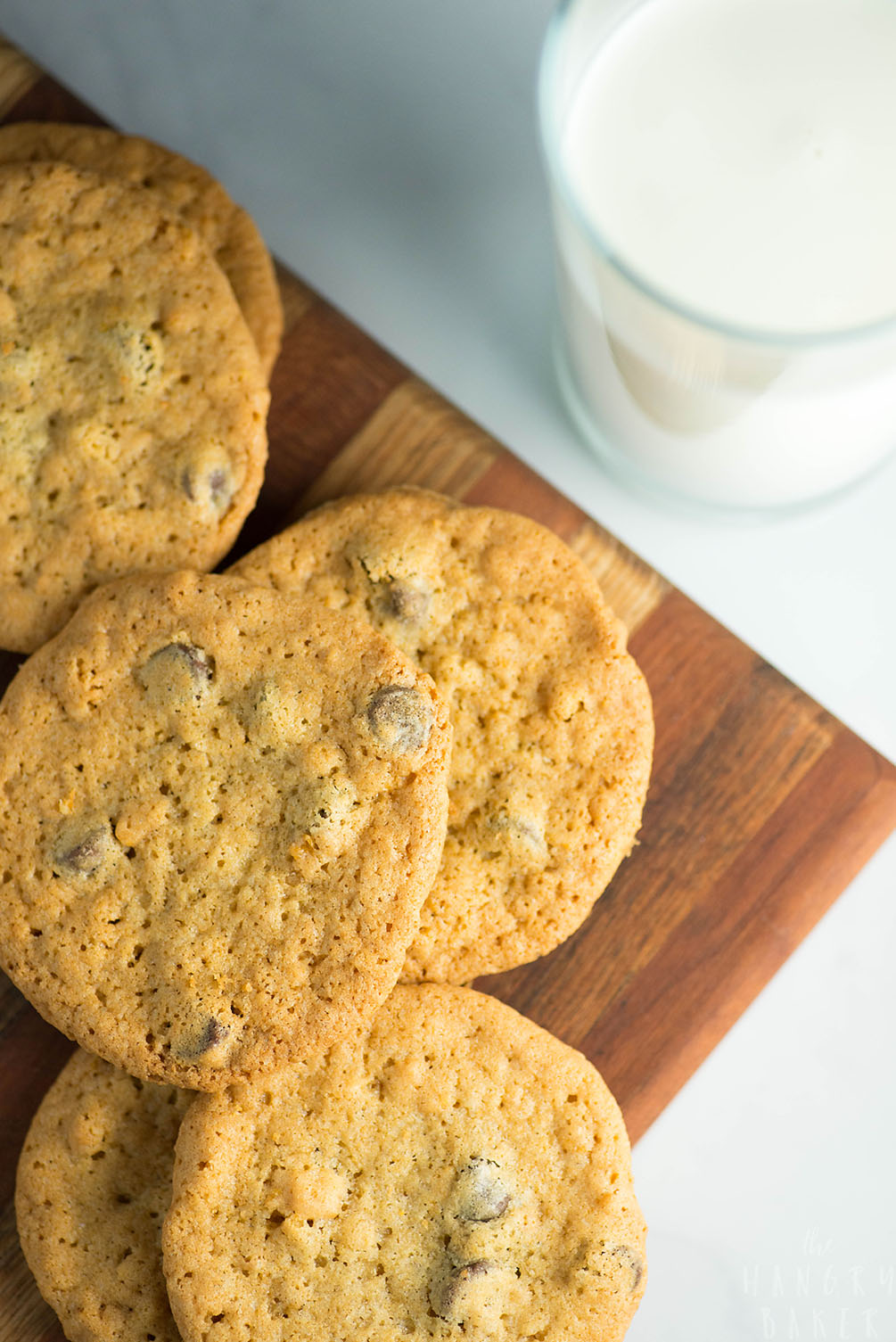 Crunchy and Chewy Chocolate Chip Cookies - the perfect balance of crunchy AND chewy! These thinner chocolate chip cookies are super addictive!